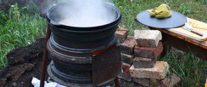 Печка из дисков колес - удобное решение на даче