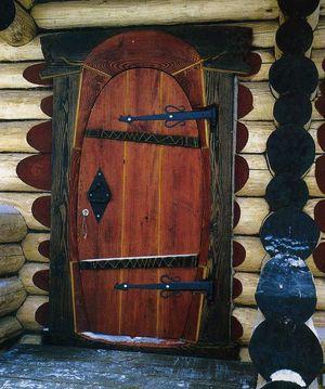 Вид деревянной двери для бани